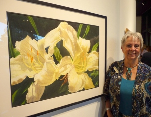 Kathy Dunham with painting of Day Lilies