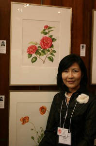 Akiko Enokido in front of her painting