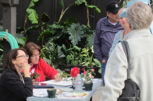 Clara Josephs (left) and Diane Daly (right) discuss botanical art and painting with visitors.