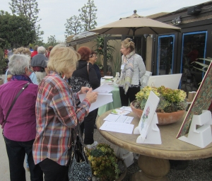 Pat Mark talking with visitors to the BAGSC Botanical Art Information Table. The Information Table also displayed books, originals and prints of contemporary and historical botanical art and scientific illustration. Photo by Peter Conlon.
