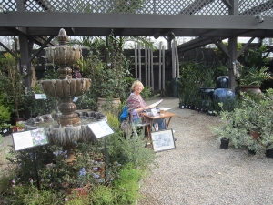 Sue Kuuskmae chose to draw in the shade section of the nursery, near a fountain. Photo by Deb Shaw.