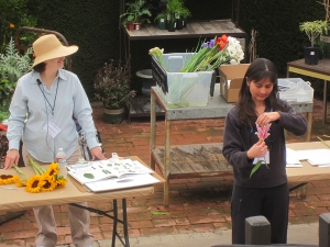 Deb Shaw (left) and Tania Marien (right) teaching a workshop about how to draw flowers and leaves in pencil. Photo by Peter Conlon.