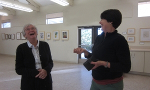 "Consider volunteering to help with the ""Artist's Favorite"" SDBG exhibition—we have a good time. Photo of BAGSC members Joan Keesey (left) and Janice Sharp (right) enjoying a laugh during the hanging of the 2013 BAGSC exhibition at the SDBG."