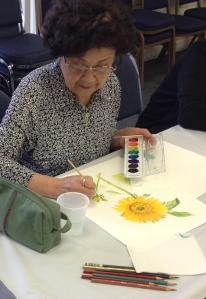 Treasurers' student working on a beautiful watercolor. Photo courtesy of Bowers Museum/Council on Aging Orange County © 2014.