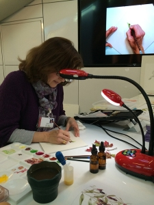 Laurence Pierson demonstrating her beautiful egg tempera technique. The camera/light in the foreground is the one mentioned in the article. Photo by Beth Stone.