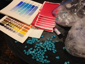 Different pigment and mixing tests on cold pressed paper, and turquoise nuggets from Arizona. Photo by Deb Shaw.