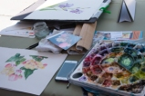 Suzanne Kuuskmae's palette and painting at her demonstration table. Photo: Linda Carpenter, © 2016, all rights reserved.
