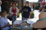 Suzanne Kuuskmae talking with visitors to the BAGSC info table about botanical art. Photo: Linda Carpenter, © 2016, all rights reserved.