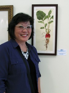 Teri Kuwahara with her prize-winning painting of a French Breakfast Radish, photo by Alvin Takamori, © 2016.