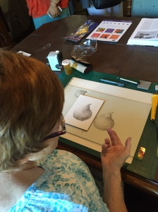 Kathy Morgan demonstrating drawing a pear. Photo by Clara Josephs, © 2016.