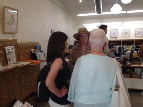 BAGSC Members and their guests gathered in the Arboretum Library for the artists' walk-through, led by Matt Ritter. (L to R): Tania Marien, Tania Norris, and Leslie Walker.