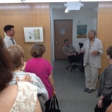 Matt Ritter and Cynthia Jackson discussing her watercolor on paper of Brachychiton rupestris, Queensland Bottle Tree.