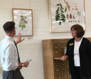 Matt Ritter talking with Diane Nelson Daly about her watercolor of Bauhinia x blakeana, Hong Kong Orchid Tree.