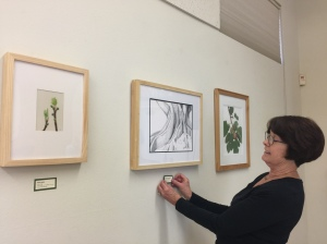 Janice Sharp placing labels throughout the exhibit. Photo by Olga Ryabtsova, © 2017.