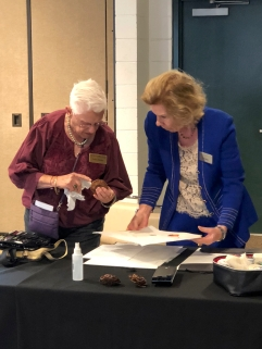 Patricia Mark setting up for the botanical art demonstration, with Leslie Walker.