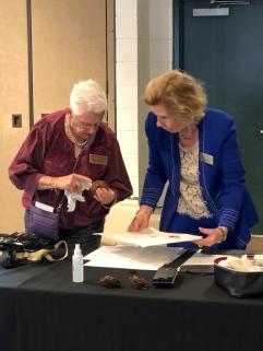 Patricia Mark setting up for the botanical art demonstration, with Leslie Walker.