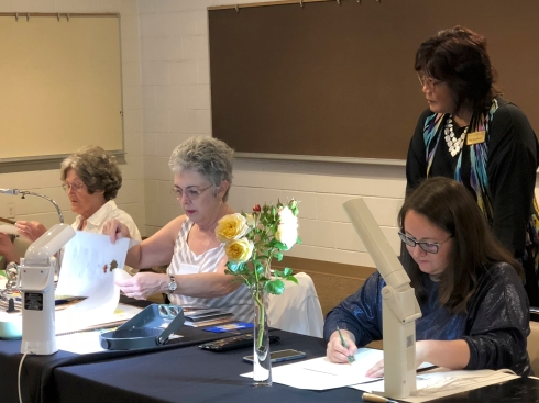 BAGSC members setting up for the botanical art demonstrations. L to R (seated): Estelle DeRidder, Jude Wiesenfeld, Olga Ryabstova; (standing) Teri Kuwahara.