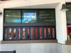 Digital signage above the ticket booths at the front entrance.